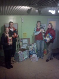 Four team members with the donations for Presents for Pets